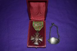 A French WW1 Croix de Guerre 1914/18 Medal with ribbon and having two stars along with a white metal