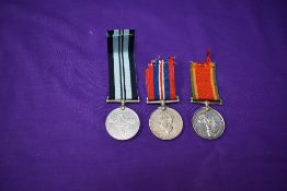 A 1939/45 War Medal and a Africa Service Medal, both named N24318 AS. Modise along with a unnamed