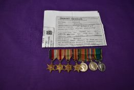 A group of WW2 miniature medals with photocopied Discharge Certificate to Arthur William James
