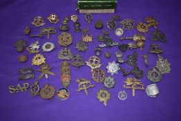 A collection of Military Cap Badges including The Buffs, Devonshire, Middlesex, Suffolk, Borders,