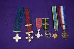 A Collection of Six Miniature Medals, 1914 Star Mons Clasp, George Cross, Distinguished Service