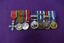 A group of three miniature medals, The Order of the British Empire Medal, Defence Medal and War
