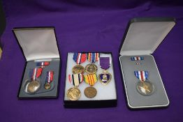 A Collection of seven US Medals Purple Heart, Silver Star, Kosovo Campaign x2, Vietnam, Iraq and War