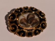A Victorian mourning brooch having hair panel within a black enamel border, dated 1891 to reverse,