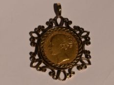 An 1860 gold shield sovereign in a removable 9ct gold decorative pendant mount, approx 13.4g