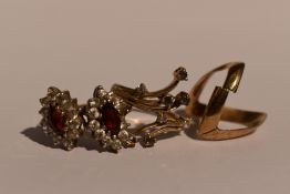 A lady's dress ring having alexandrite and diamond chips in a stylised mount, one stone missing,