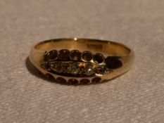 A lady's dress ring having five small old cut diamonds in a pave set boat mount on a yellow metal