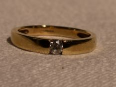 A lady's dress ring having a tension set cubic zirconia in a 14ct gold band, size M &approx 2.7g