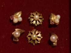 Three pairs of 9ct gold and yellow metal stud earrings having seed pearl decoration, approx 1.9g