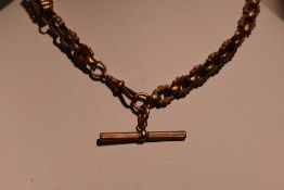 A Victorian rolled gold fancy link watch chain of chunky form having dog leash clasp and T bar