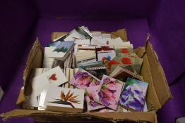A box full of unused floristry gift cards.