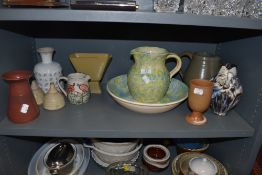 An assortment of studio pottery including jugs, vases and cruet set.
