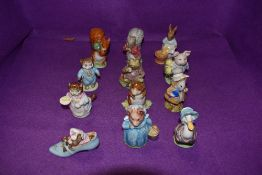 A collection of twelve Beswick Beatrix Potter figures, Amiable Guinea-Pig, Aunt Pettitoes, Tom