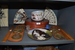 A variety of items including horse brasses, display plate, wooden rules and fans.