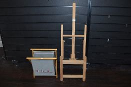 An easel and a knitting bag.