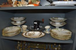 A good quantity of French plates and cake stands having floral pattern and gilt detailing,two