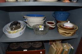 A mixture of kitchen ware amongst which are vintage earthen ware mixing bowls,jelly mould,dishes and