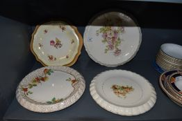 A selection of vintage dessert serving plates having bright floral patterns,five in total.