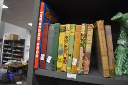 A selection of vintage Enid Blyton books and a copy of the Beano book.