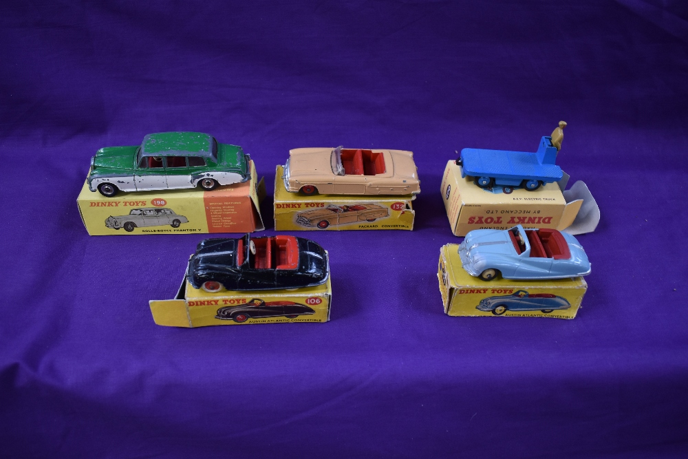 Five Dinky diecasts, Austin Atlantic Convertible in black with red interior, white tyres and red