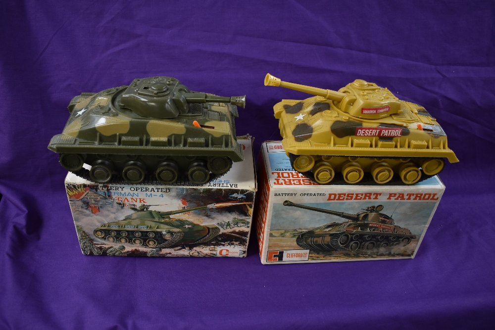 Two Clifford Toys battery operated and plastic Tanks, Sherman M-4 and Desert Patrol, both boxed