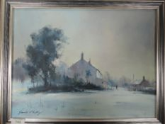 An oil painting, Gerald Phillips, winter village, signed and dated, 1988, and attributed verso, 29 x