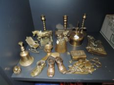 A selection of brass fire side items including candle sticks and terrier dog door knocker
