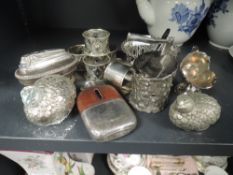 A variety of vintage plated ware including desk top lighter, salt and pepper pots in the form of