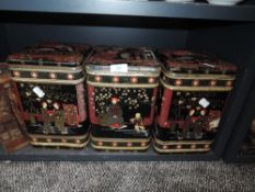 Three large oriental style tea tins.