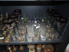A mixed lot of vintage glasses including coloured cut glass and coloured glass with gilt