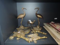 A collection of animal themed brass decorative items including three brass wall mounted flying