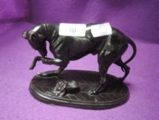 A vintage spelter figure of a greyhound nursing a poorly leg.