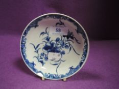 A Worcester pin dish having blue and white floral decoration, around late 1700s.