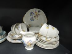 A part tea service by Durham China with floral design