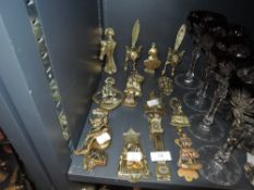 A varied lot of brass door knockers including foxes, Harrow school, horses and more, thirteen in