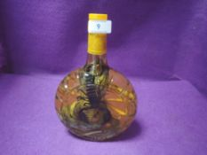 A bottled Cobra and scorpion in herb water,possibly Asian, for ornamental purposes only!