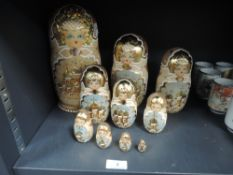 A set of ten Matryoshka dolls having hand painted design with gilt detailing.
