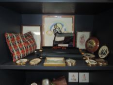 A mixed lot containing a selection of frames and miniatures,tourist collectables and more.