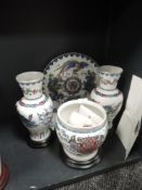 A collection of vases, a planter and charger with stands,having Chinese design with gilt detailing,