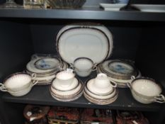 A part Aynsley Leighton dinner service having white ground with royal blue edge and gilt motif