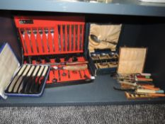 A selection of cutlery and flatwares including fruit knives and Oneida cased canteen