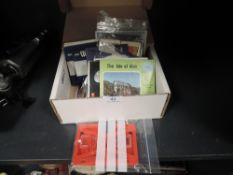 An assortment of Viewmaster slides and similar including Isle of Man,moon landing and Devon