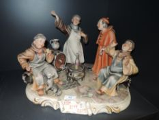 A ceramic figure base by Cappo De Monte depicting monks getting drunk