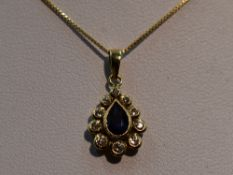 A sapphire and diamond teardrop cluster pendant in a yellow metal mount, marks worn, probably 18ct
