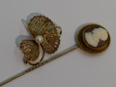 A 9ct gold brooch of stylised floral form having central cultured pearl, and a conch shell cameo pin