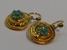 A pair of 9ct gold drop loop earrings of circular form having turquoise decoration