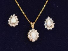 An opal and cubic zirconia oval cluster pendant on a 9ct gold chain, approx 17' with matching stud