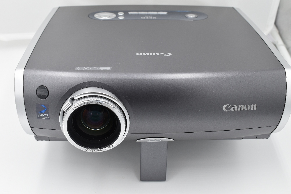 A Canon XEED SX50 multimedia projector with remote control in a Pelican 1600 hard case