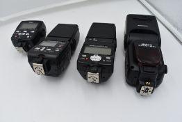 Four Nikon Speedlight flashguns in a hard Peli 1600 case. A Nikon Speedlight SB-900, a Nikon