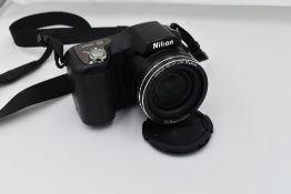 A Nikon L100 digital camera with user manual